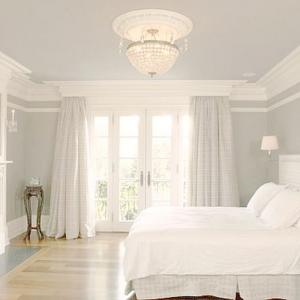 white-english-country-house-bedroom-with-crown-molding.jpg
